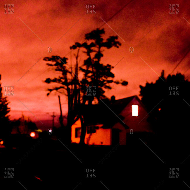 Light on in House at Night with Red Sky