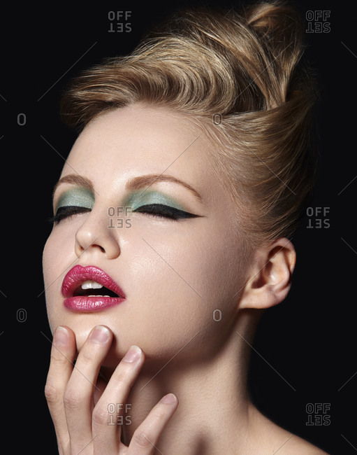 Model with winged eyeliner and pink lipstick