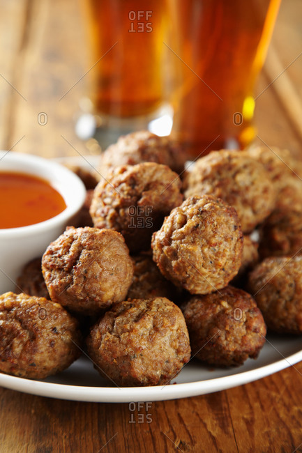 Close-up of meatball pile with dip