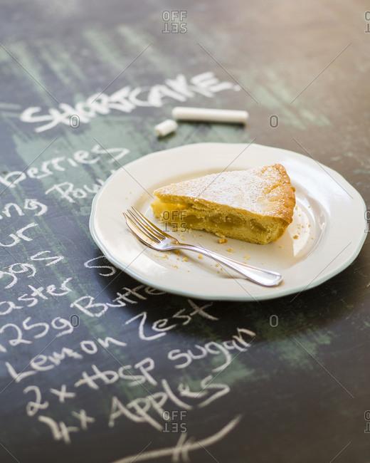 Piece of Apple shortcake on blackboard with recipe