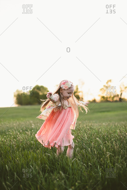 Girl dancing at a grass field