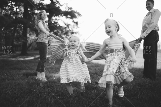 Happy smiling family in meadow