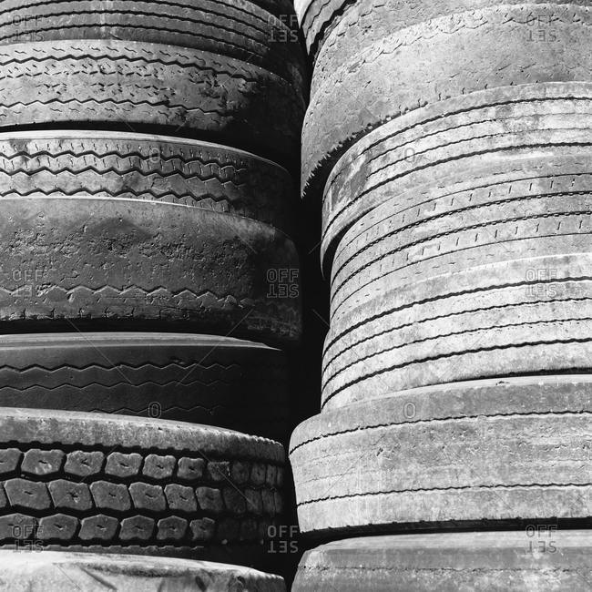 Close up of track of discarded worn old automobile tyres