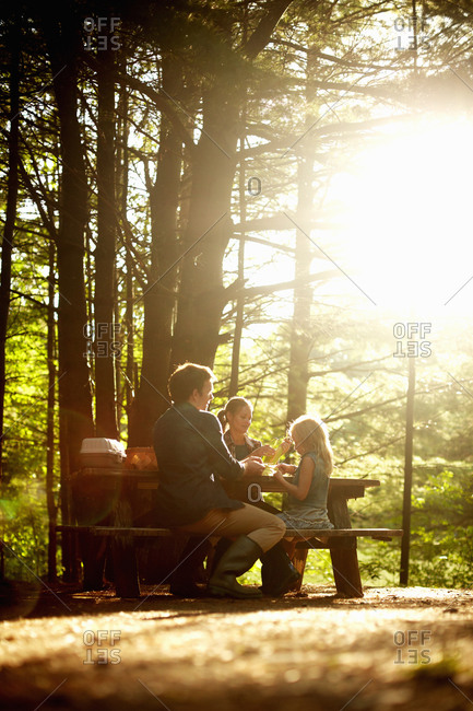 Happy family rest in forest