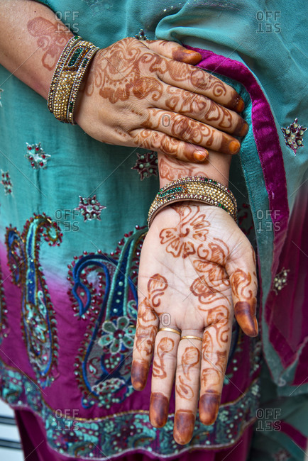 Detail of a woman's hands adorned with henna (mehndi), India