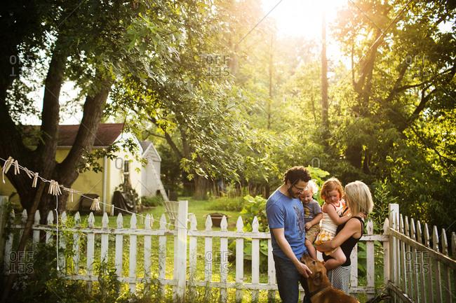 Family standing in garden - Offset