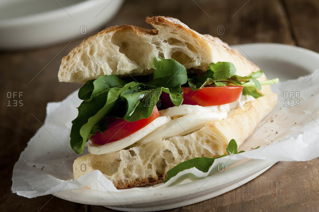 Mozzarella, tomato and arugula sandwich