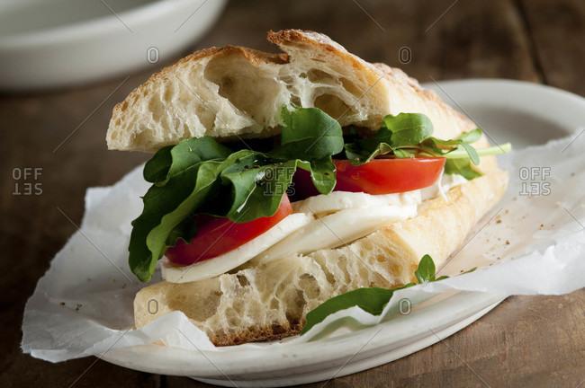 Mozzarella, tomato and arugula sandwich