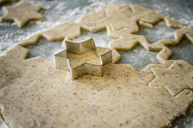 Cutting out star-shaped cookies