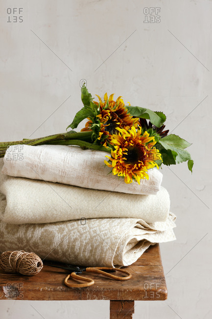 Sunflowers on a stack of folded blankets