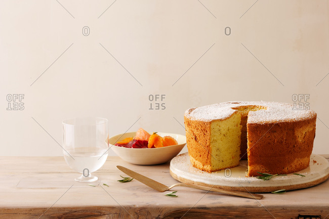 Olive oil cake with rosemary and fresh citrus fruits