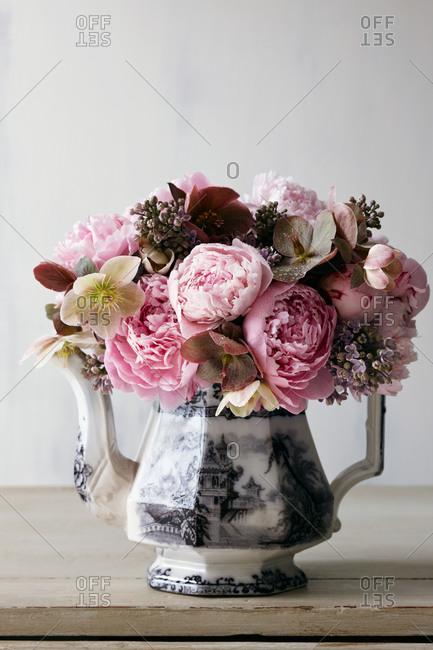 Still life of bouquet in teapot