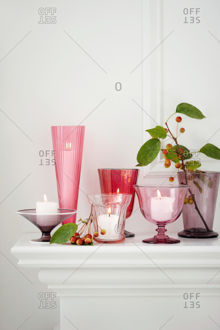 Still life of various candles on mantelpiece