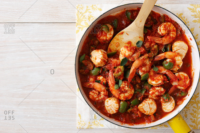 Top view of shrimp with tomatoes and olives