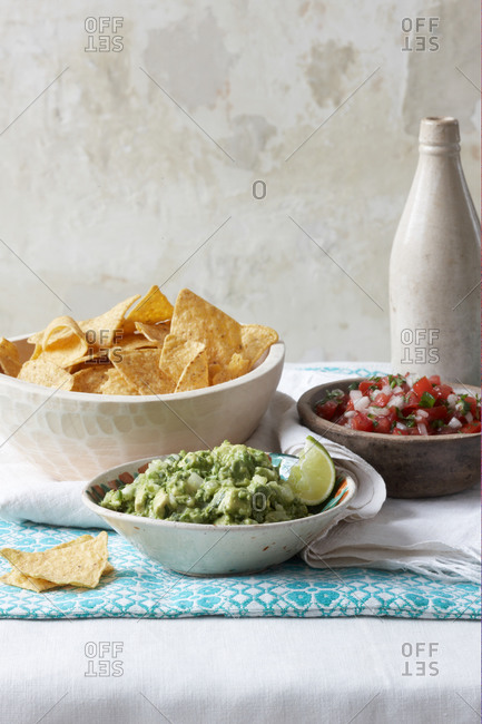 Still life of guacamole and salsa with tortilla chips