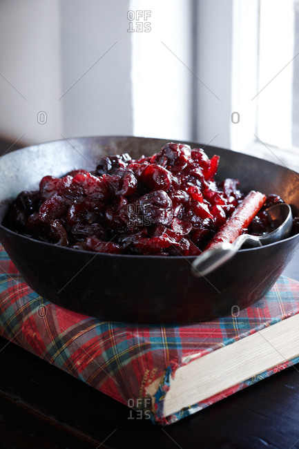 Cherry and orange compote in saucepan