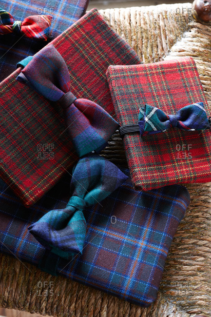 Gifts wrapped in tartan fabric decorated with bow ties