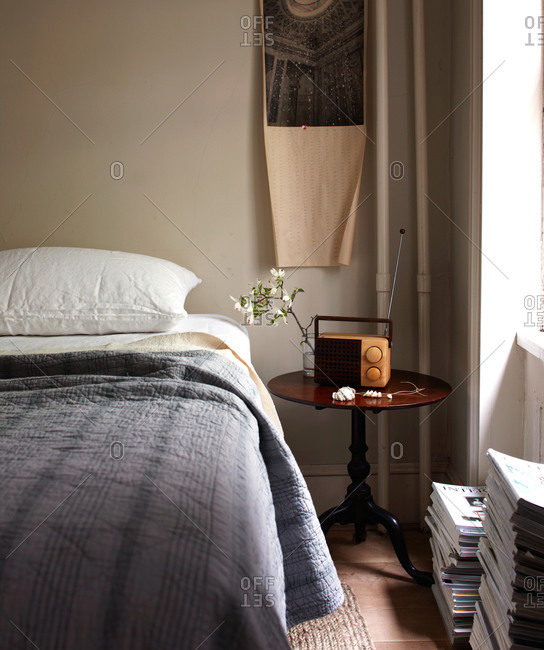 Bedroom corner with round side table and radio