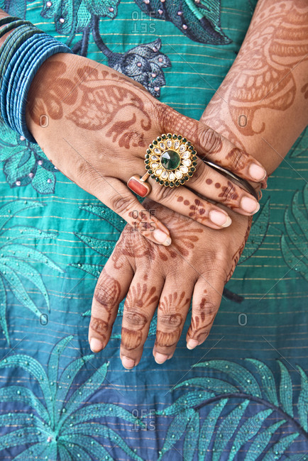 Detail of an Indian woman's hands adorned with jewelry and hennay (mehndi), Jaipur, India