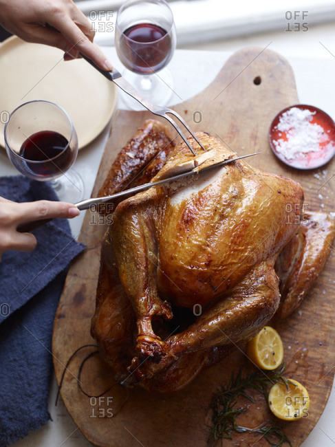 Traditional roasted turkey on wooden cutting board