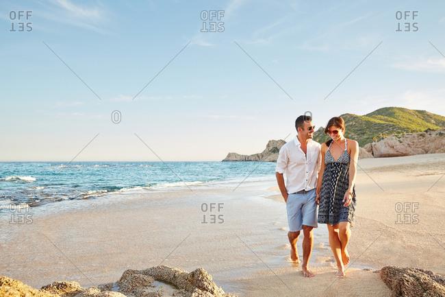 Couple enjoying a walk on the beach