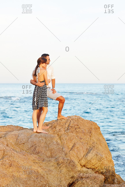 Couple enjoying the view from the top of a rock