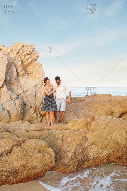 Couple enjoying a walk at the beach