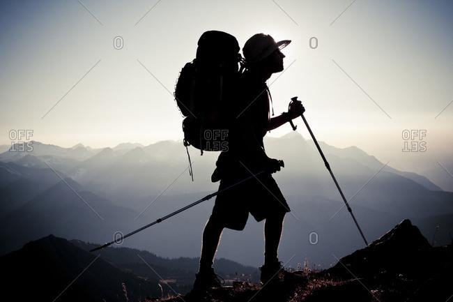Silhouette of an alpine hiker