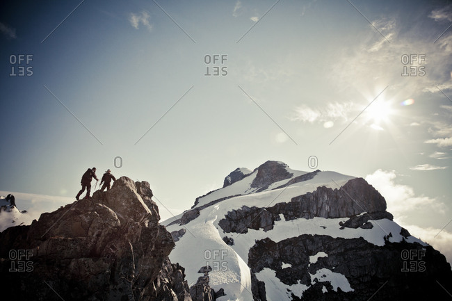 Low angle view of two mountain climber on a peak