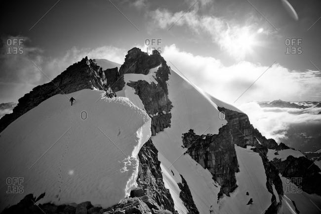 Climber trudging toward the apex