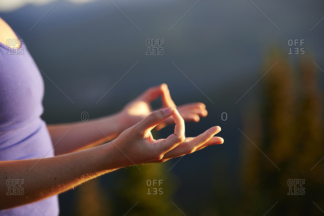 A woman's hands in meditative pose