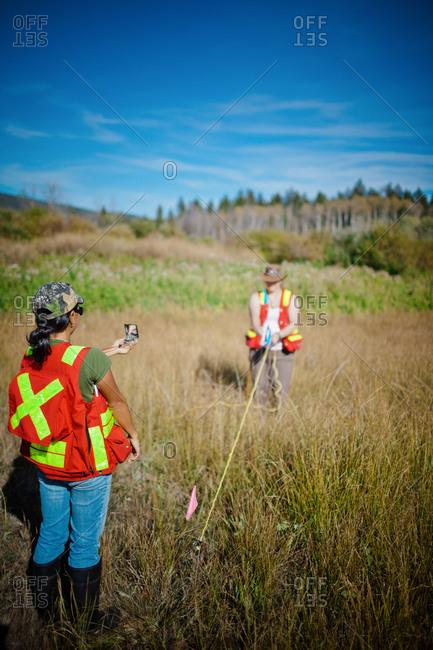 Surveyors taking measurement - Offset Collection