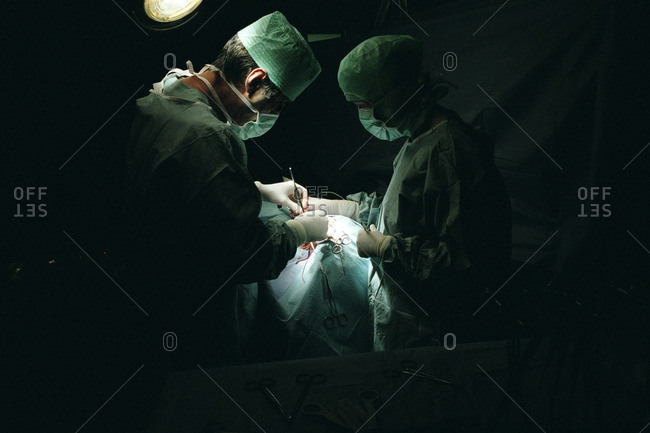 Doctors performing a carotid artery surgery