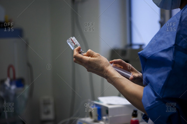 Nurse prepping an injection of adrenaline