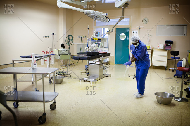 Woman disinfecting septic surgery operating theater