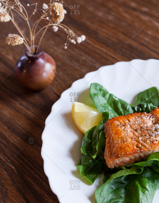 Broiled salmon on bed of spinach