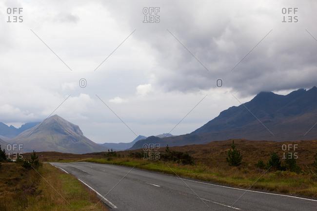 Desolate country road across Isle of Skye, Highland Scotland