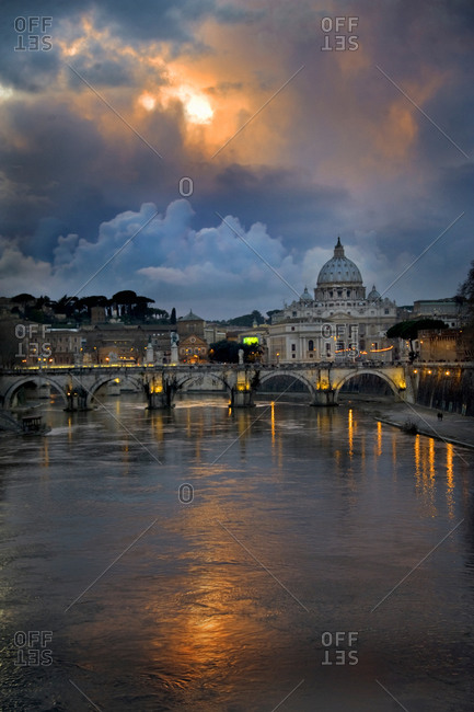 Arch bridge across Tiber River with St. Peter's Basilica in the background, Rome, Lazio, Italy