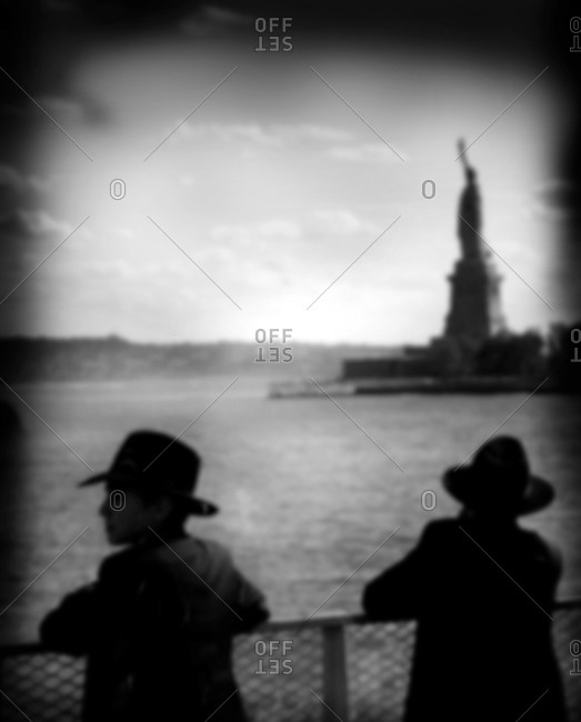 Two Orthodox Jewish boys on boat tour near Statue of Liberty