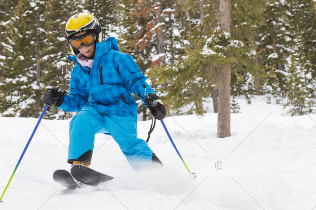 Girl skiing on snowy slope
