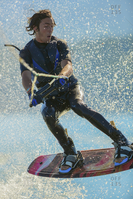 Man wakeboarding on lake