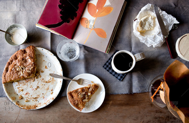 Apple cake with cup of coffee and book at home