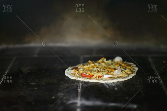 Pizza baking in brick oven