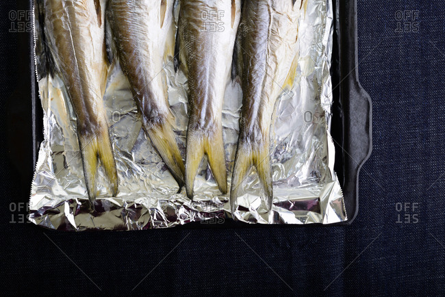Fresh roasted fishes in baking tray