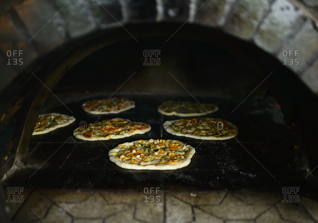 Brick oven filled with pizza