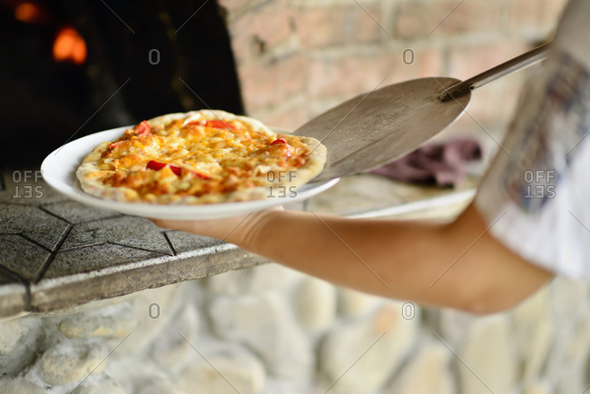 Pizza fresh out of a brick oven