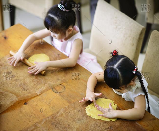 Kids rolling dough