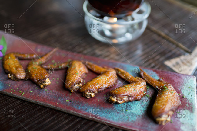 Grilled chicken wings on wooden table