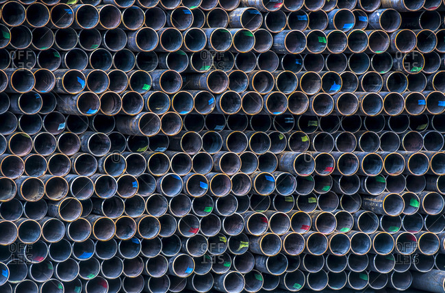 Close-up of stack of metal pipes