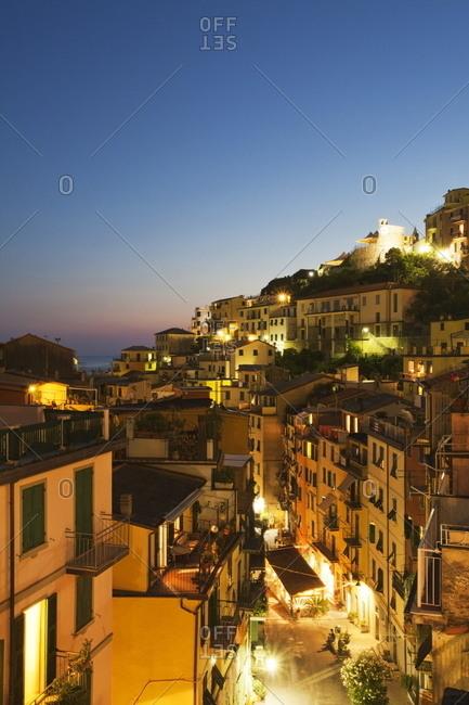 Via Colombo at dusk in Riomaggiore, Cinque Terre, Liguria, Italy